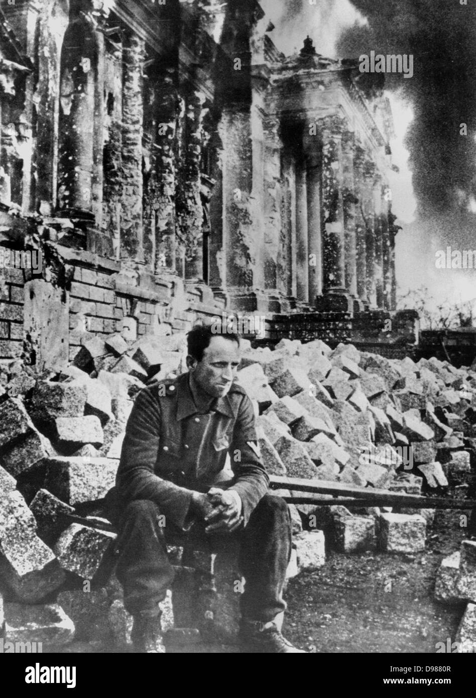 O To Ww Bing Comsquare Root 123: Second World War: German Soldier Sits Amongst The Ruins Of