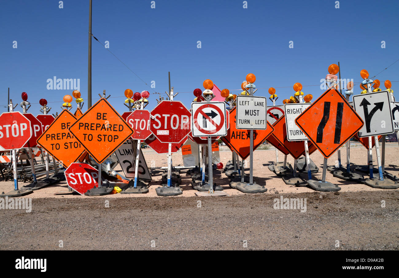 Construction Traffic Control : Traffic control signs await placement at a road