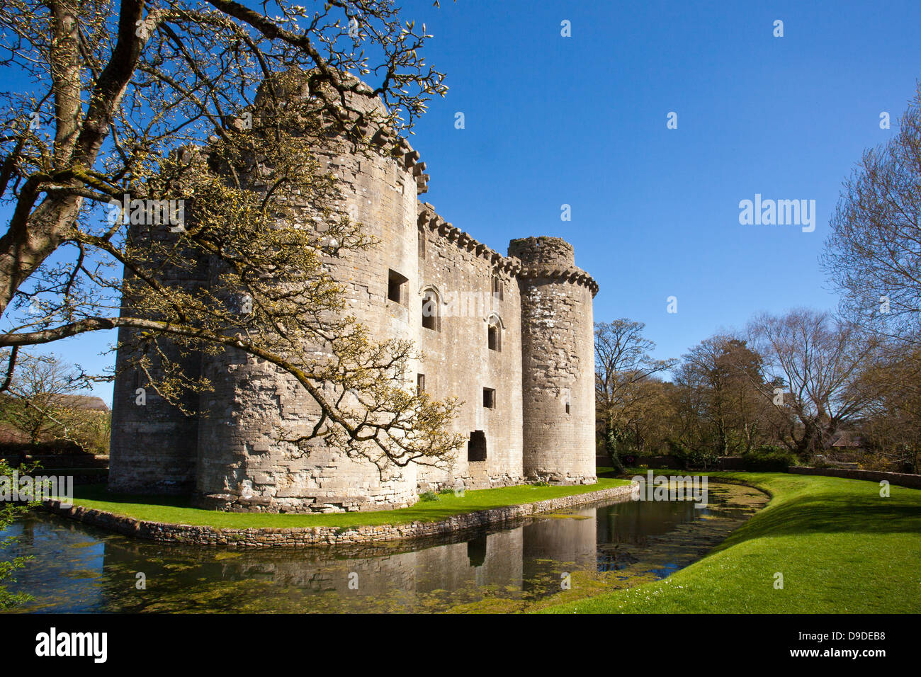 The Ruins Of Nunney Castle Surrounded By Its Moat Built