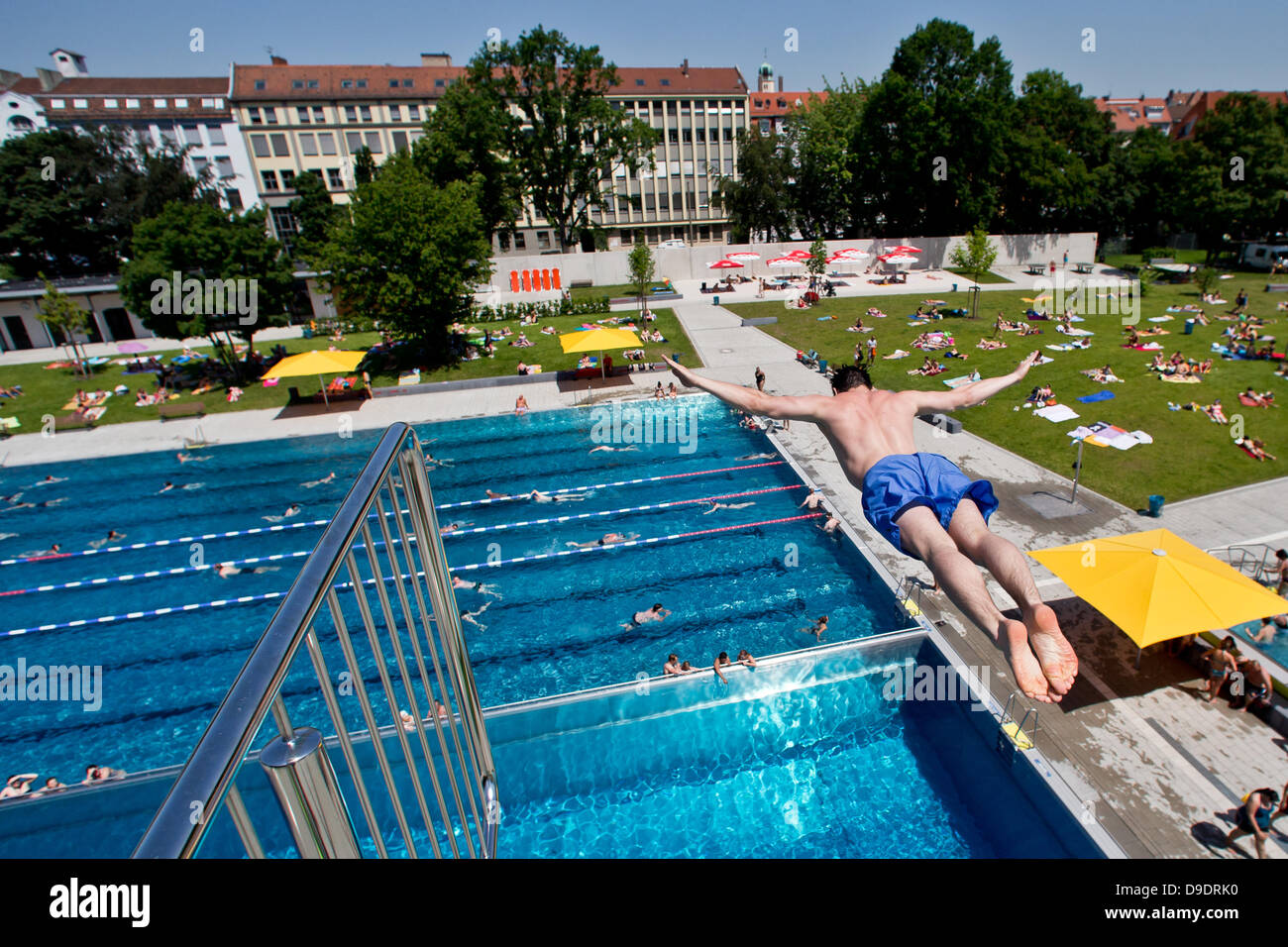 A Man Jumps Off A Diving Platform At Open Air Swimming Pool Westbad Stock Photo Royalty Free