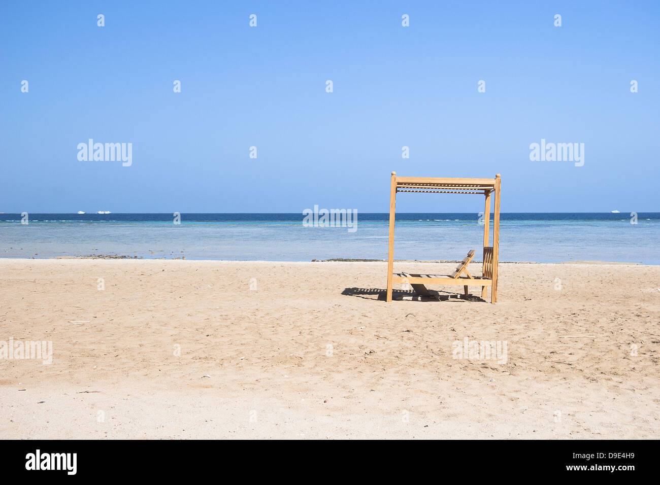 Wooden beach lounge chair - Stock Photo Wooden Beach Lounge Chairs Along The Shoreline