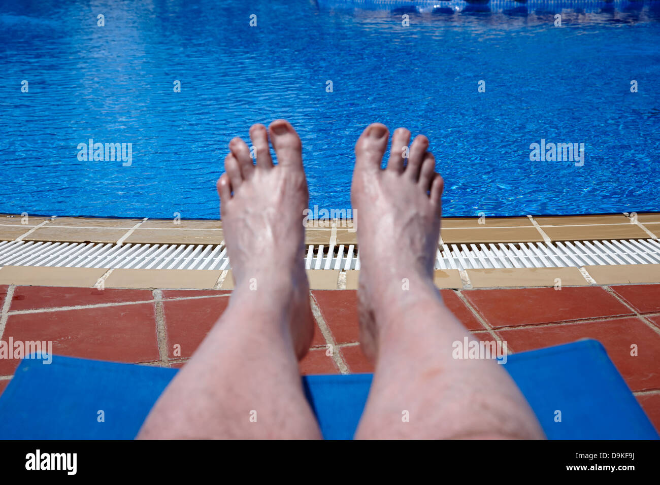 Mans Feet And Legs By The Side Of A Swimming Pool On Holiday Salou Stock Photo Royalty Free