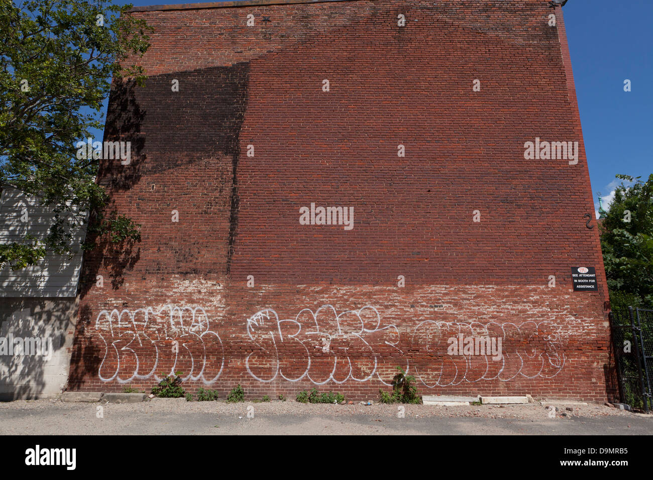Graffiti On Side Of Brick Building