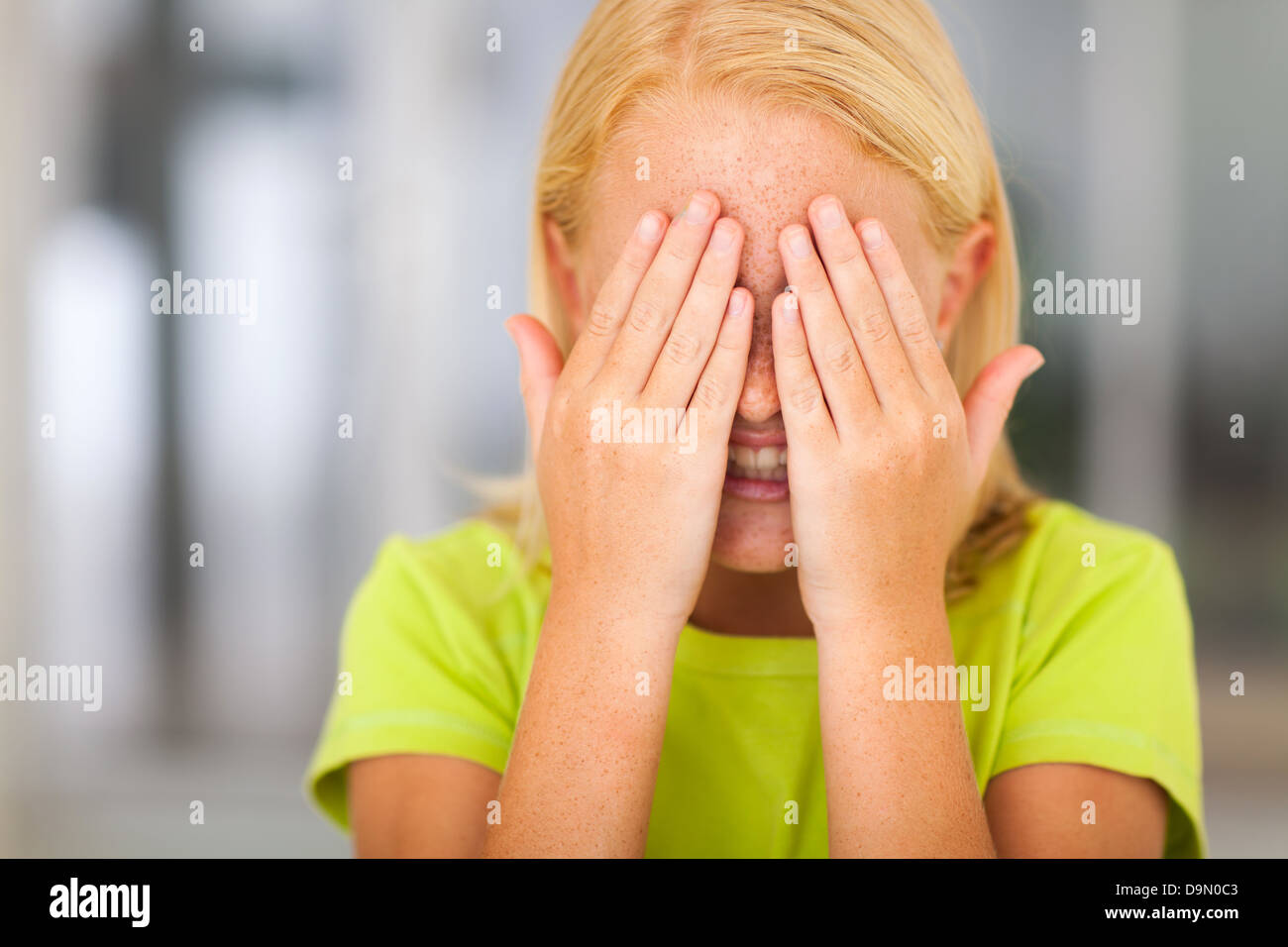 cute little preteen girl hands covering face Stock Photo: 57624339 ...