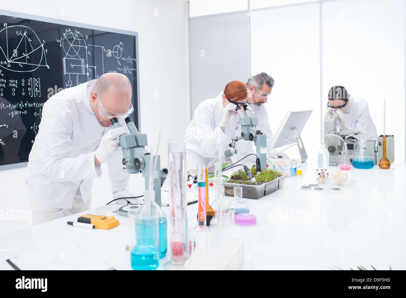 sideview of researchers in chemistry lab analyzing under – Lab Chemist