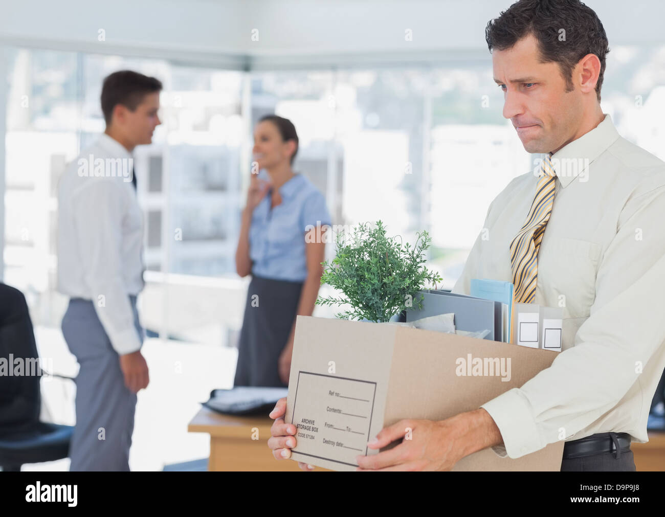 businessman leaving office after being fired stock photo royalty businessman leaving office after being fired