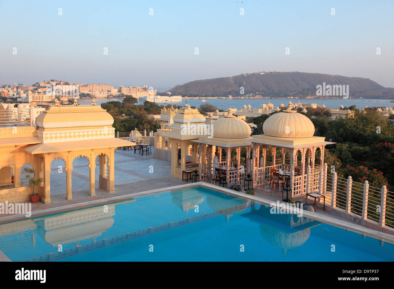 Swimming Pool And Hotel Rooftop Pavilions With Taj Lake Palace In The Stock Photo Royalty Free