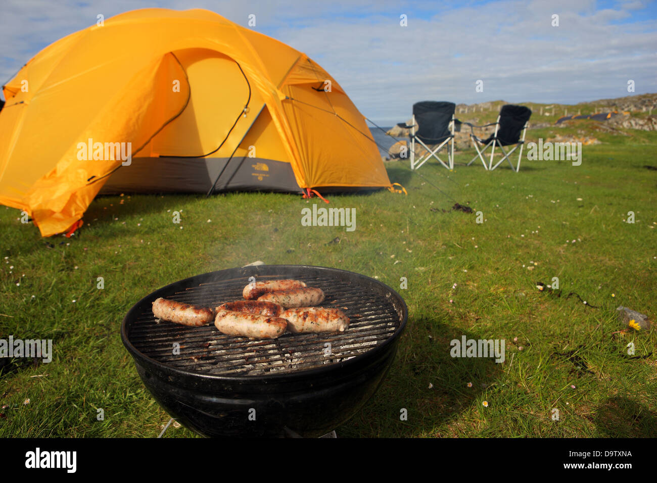 Sausages cooking whist c&ing with tent and chairs by the sea in Scotland & Sausages cooking whist camping with tent and chairs by the sea in ...