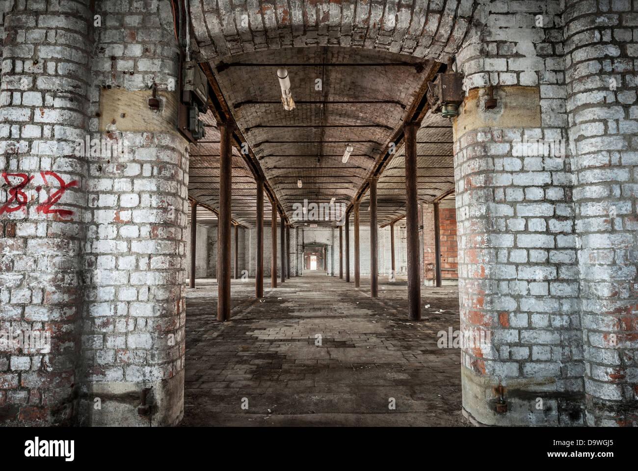Abandoned Victorian Warehouse Interior With Rusting Iron Pillars.
