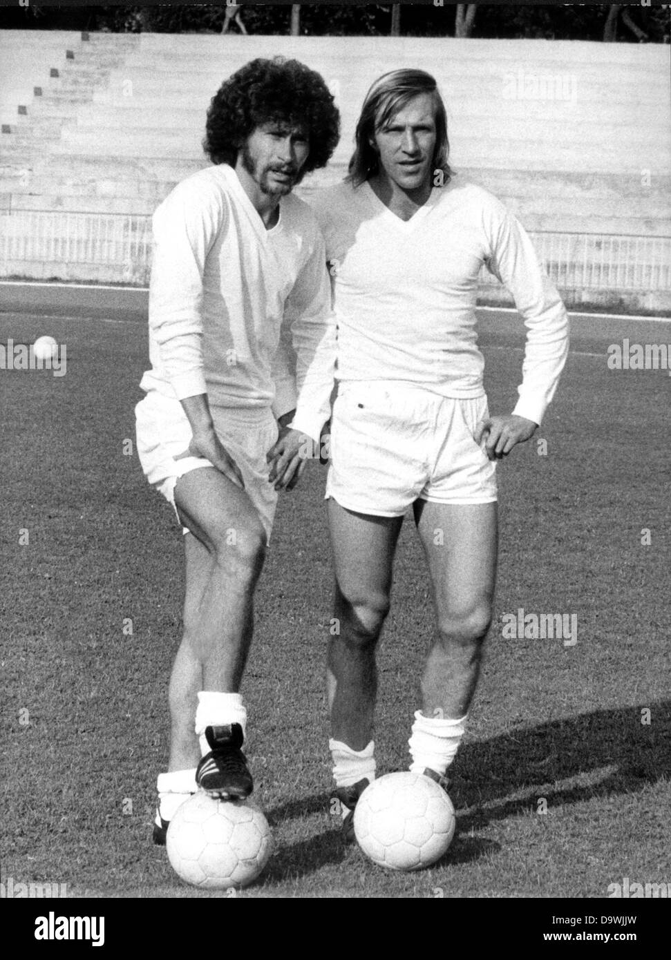 German players Paul Breitner l and Günter Netzer r play for
