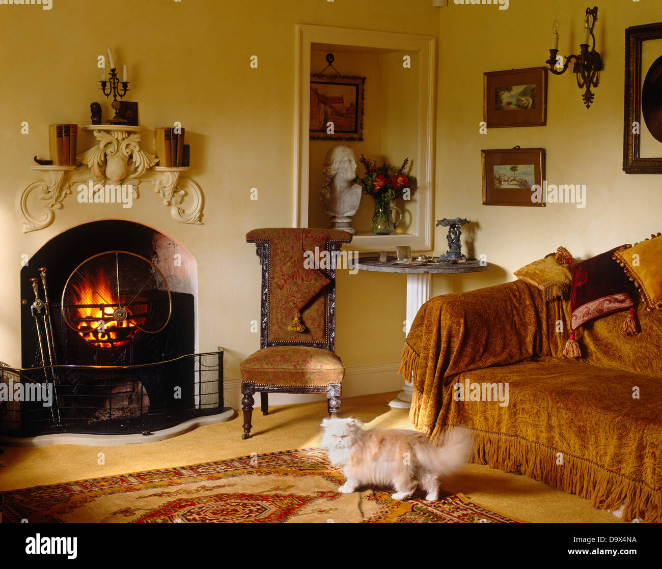 Gold Chenille Throw On Sofa In Country Sitting Room With Low Upholstered  Chair Beside Fireplace