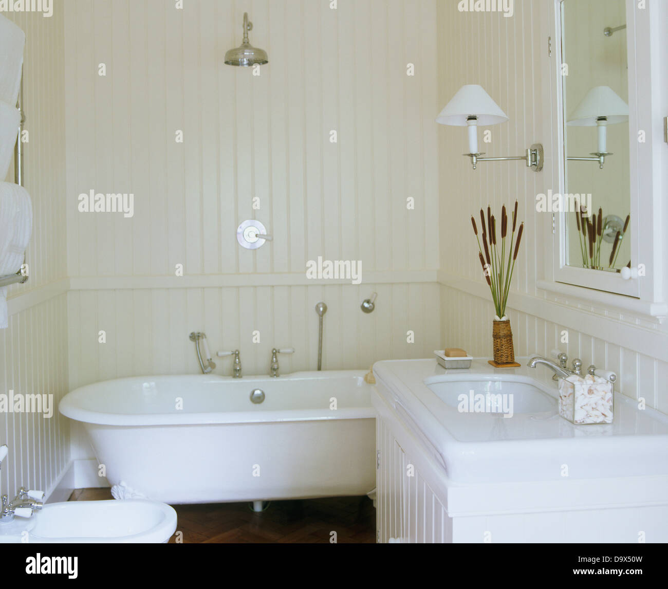 Chrome Shower Above Roll Top Bath In White Bathroom With White Painted  Tongue+groove