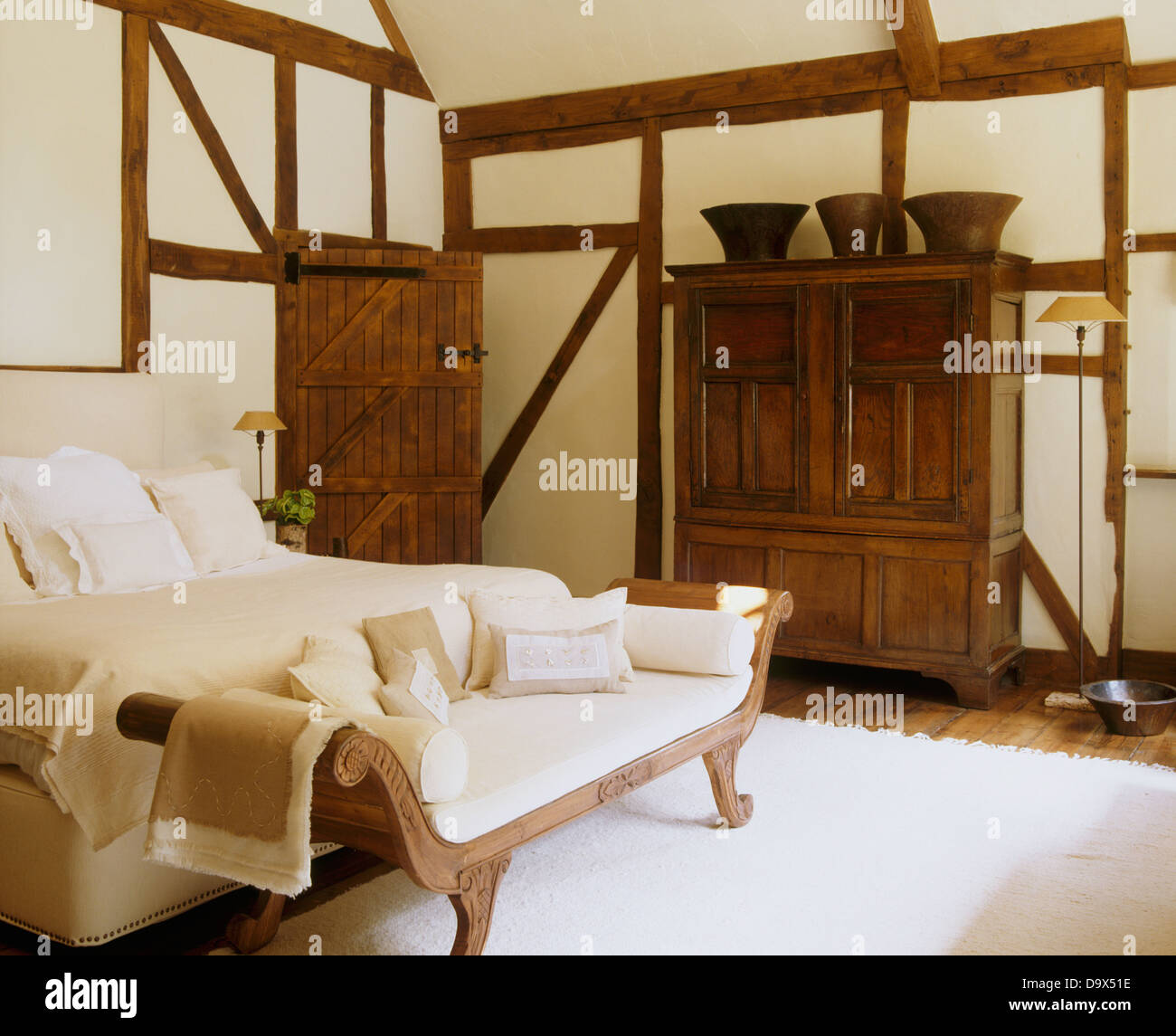16th century cupboard and empire style daybed in beamed for Empire style bed