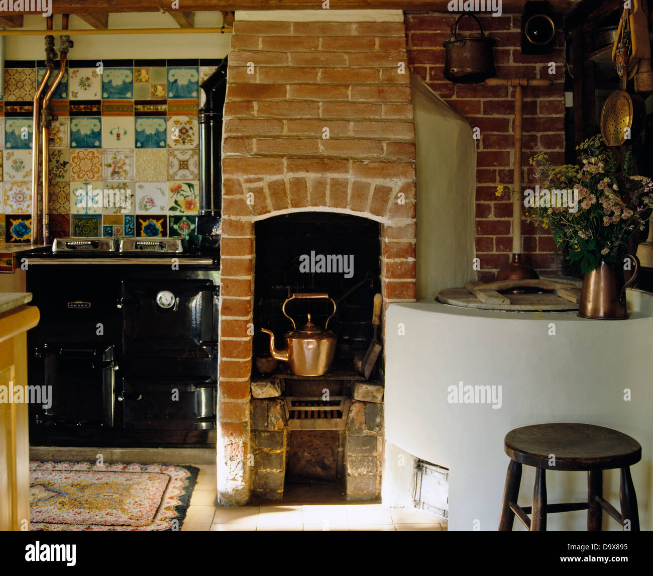 copper kettle on original brick stove in country kitchen with