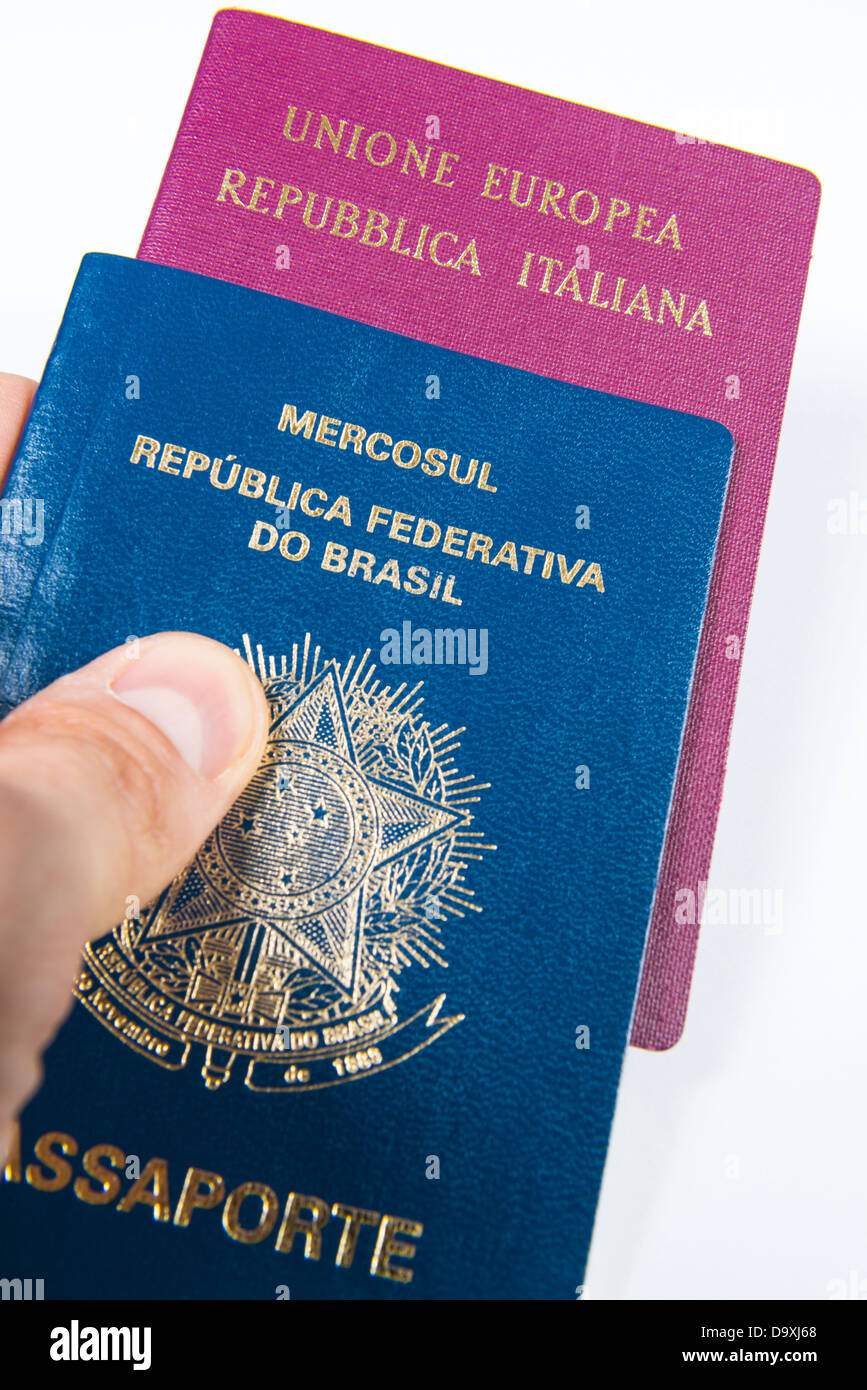 Dual passport stock photos dual passport stock images alamy close up of hand handing out brazilian passport with italian passport inside isolated on falaconquin
