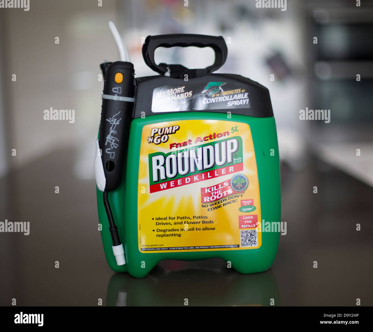 Weeds in flower beds spray - Round Up Roundup Weed Killer Spray Monsanto Stock Image