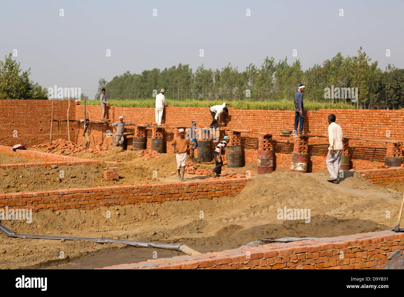 India Uttar Pradesh Aligarh Men Building Brick Wall