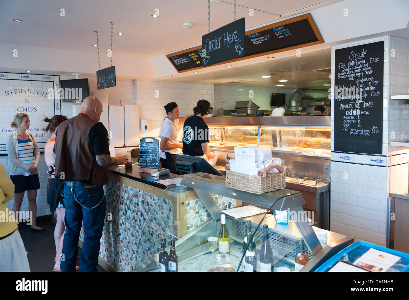 Customers inside rick steins fish and chip shop padstow for Rick s fish and pet