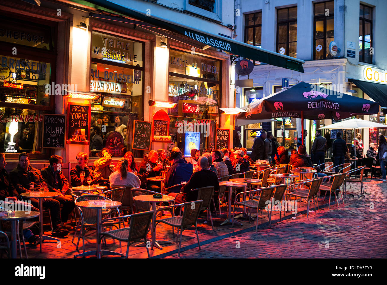 patrons eat and drink at outdoor seating outside a pub bar in the stock photo royalty free. Black Bedroom Furniture Sets. Home Design Ideas
