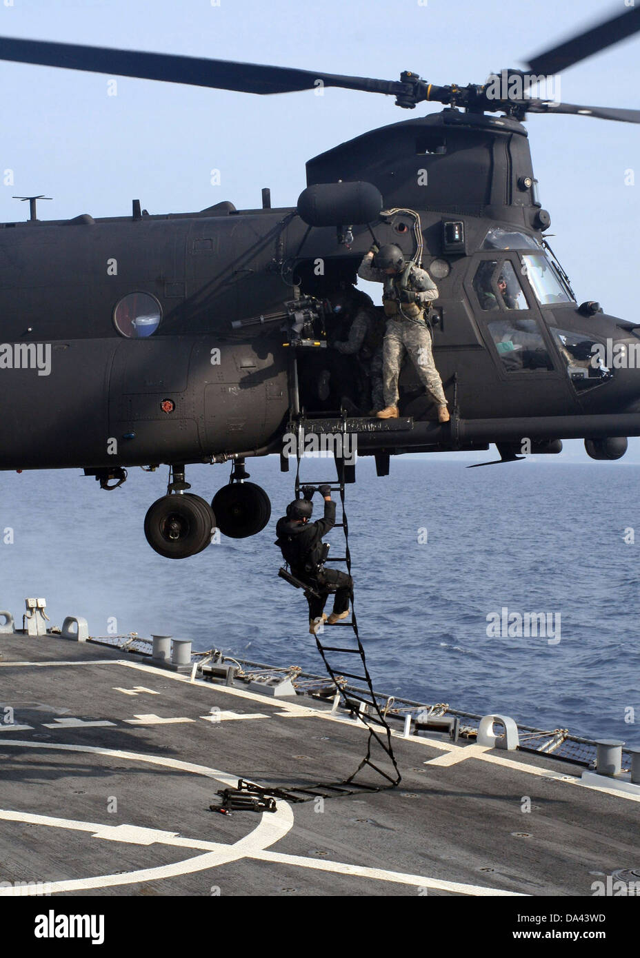 Stock Photo US Air Force Special operations forces fast rope from an MH 47 Chinook helicopter onto the guided missile destroyer USS Higgins during