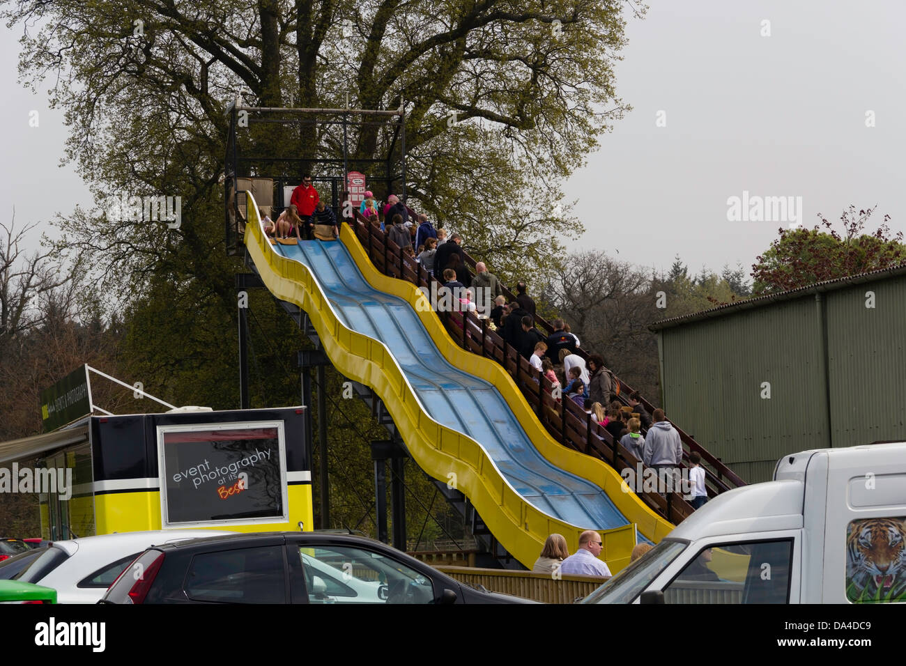 a slide with kids and parked cars inside the blair drummond safari
