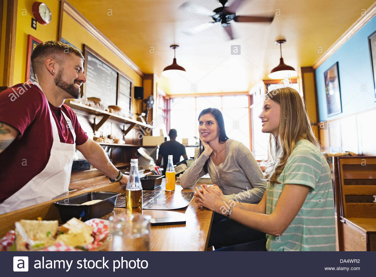 deli counter stock photos deli counter stock images alamy male deli owner talking to customers at deli counter stock image