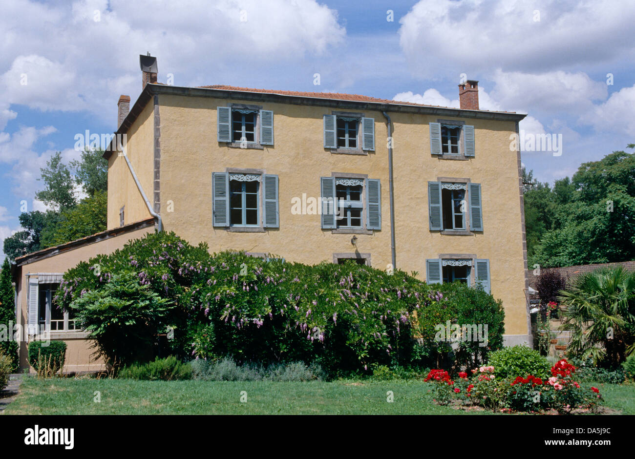Exterior Of French Country House With Blue Shutters