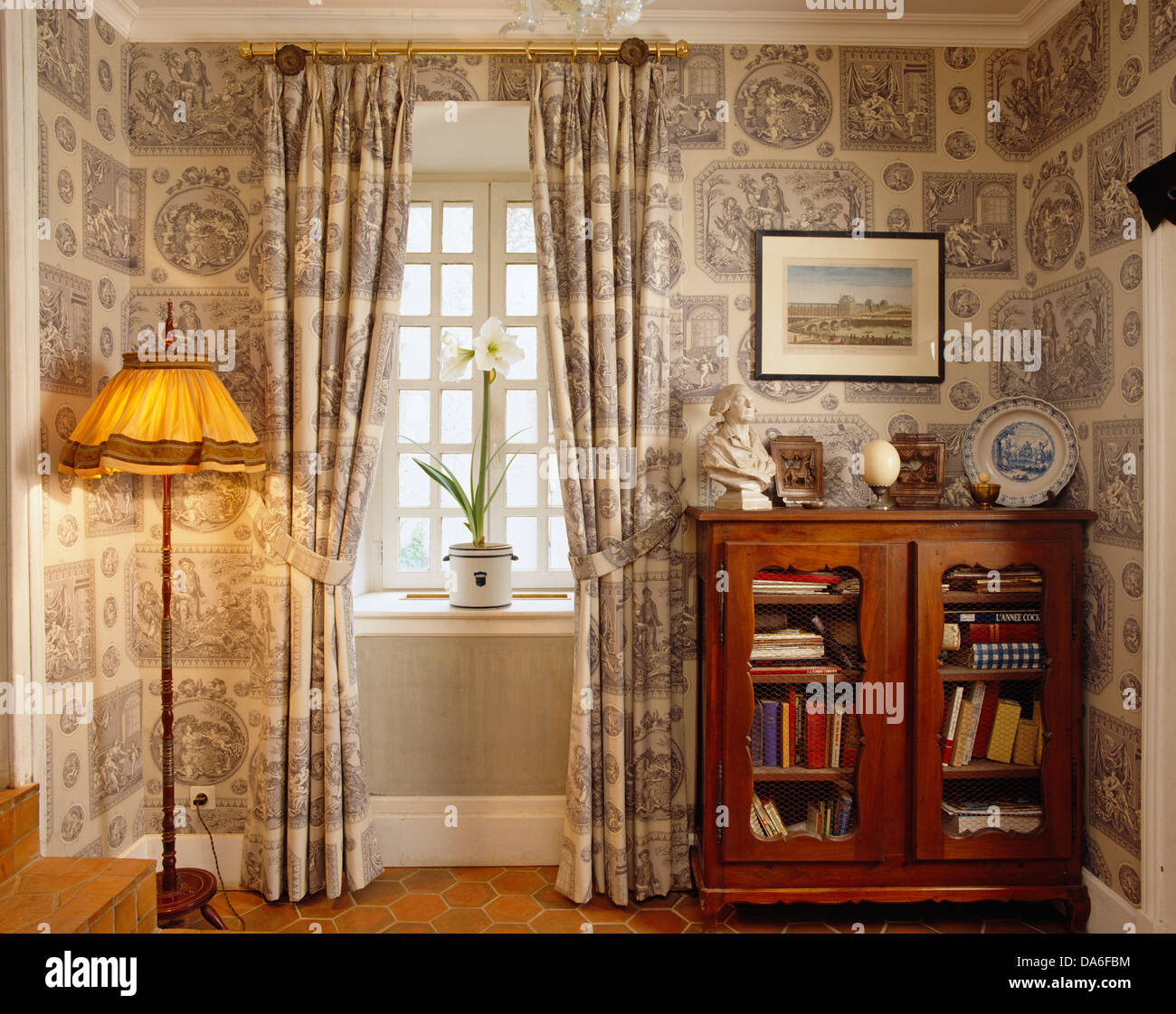 Gray+white Curtains And Coordinating Wallpaper In Small Room With Lighted  Floor Lamp And Small Glass Fronted Cabinet
