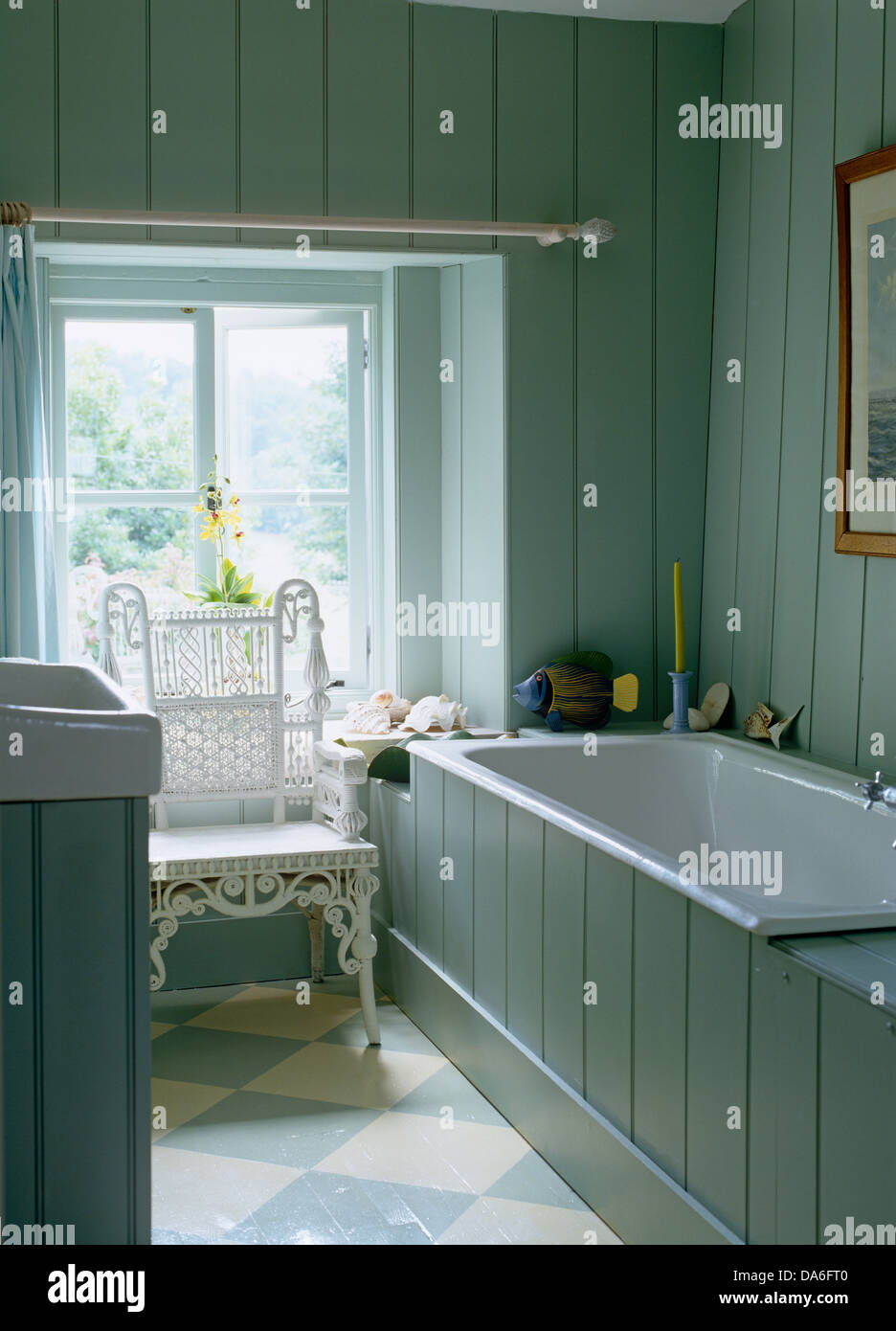 Tongue and groove for bathrooms - Stock Photo White Wicker Chair And Painted Floor In Country Bathroom With Pale Blue Tongue Groove Paneled Walls And White Bathtub