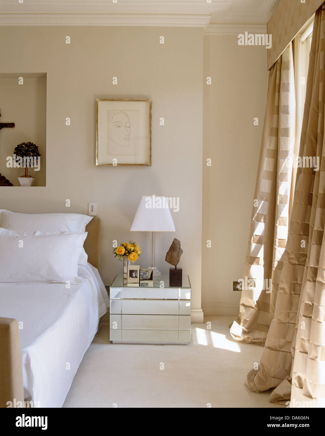 Ordinaire White Lamp On Mirrored Bedside Table Next To Double Bed In Contemporary  Bedroom With Opulent Cream Silk Curtains On The Window