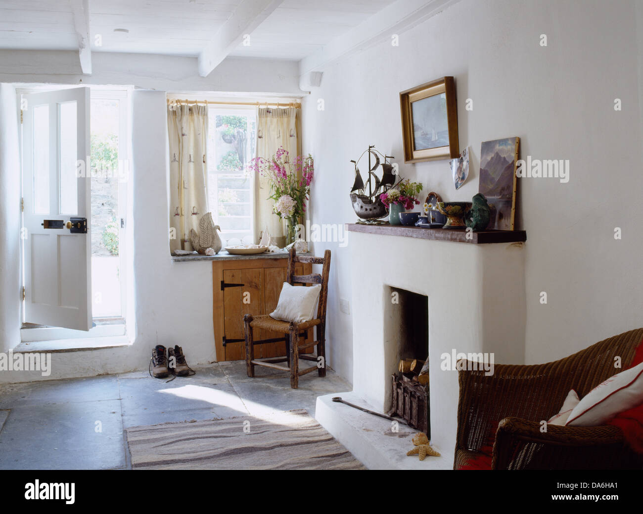 front door opening into cottage sitting room with simple white