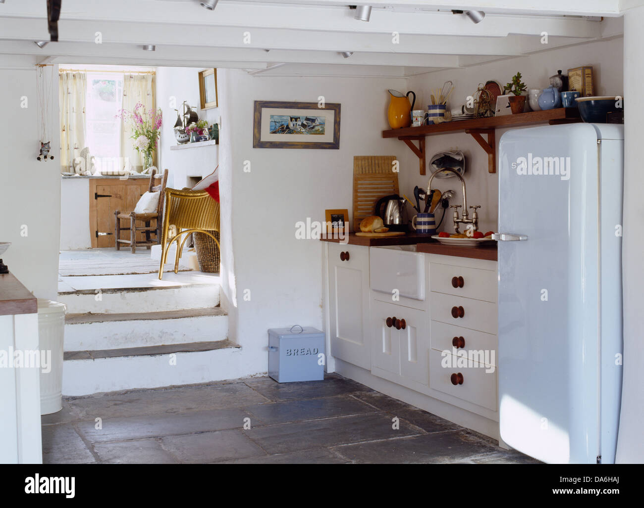 Stone Floor Kitchen Stone Steps Leading Down Into Country Style Kitchen With Pale Blue