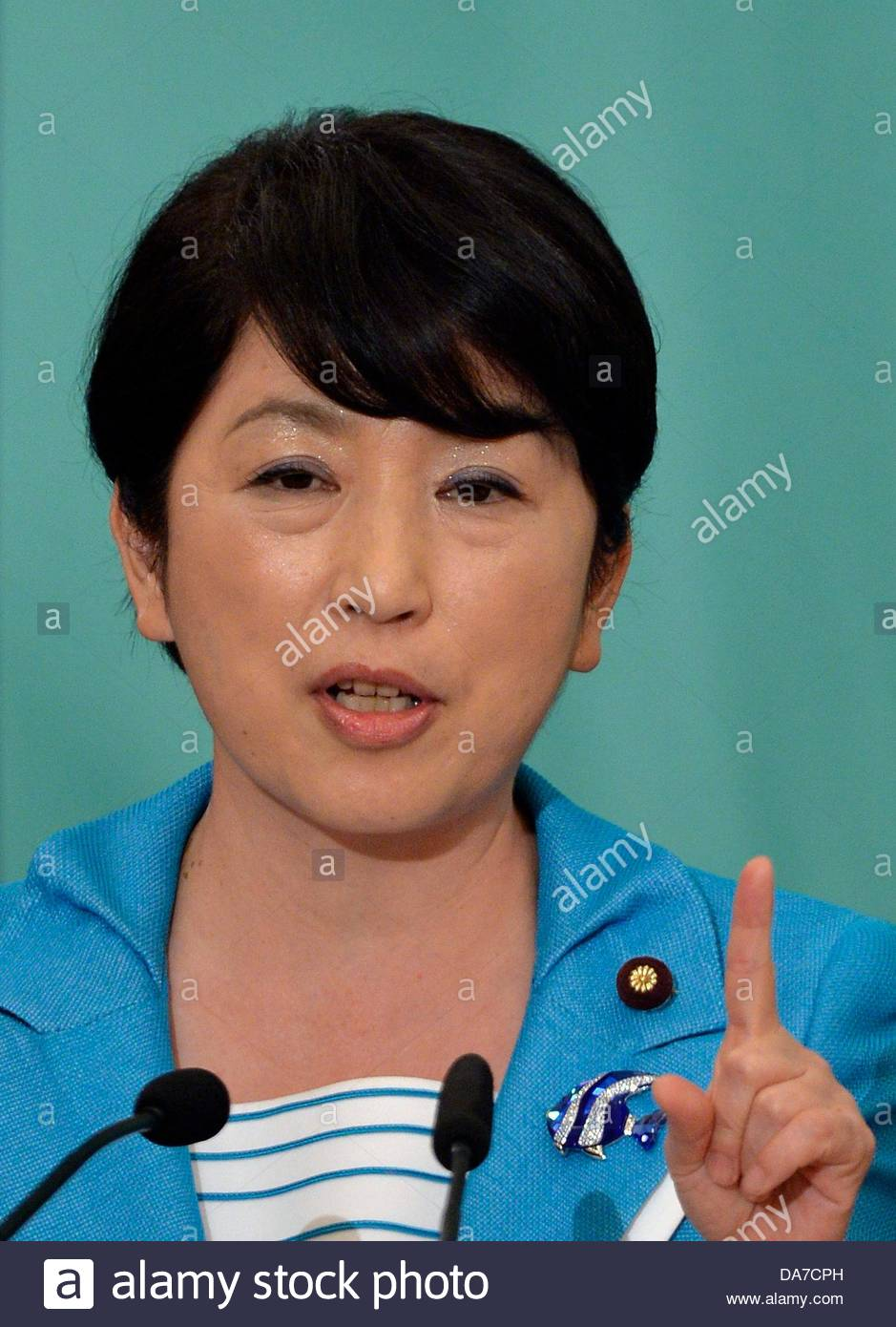 Stock Photo - epa03772503 Social Democratic Party leader Mizuho Fukushima points as she speaks during a debate at Japan National Press Club in Tokyo, Japan, ... - epa03772503-social-democratic-party-leader-mizuho-fukushima-points-DA7CPH