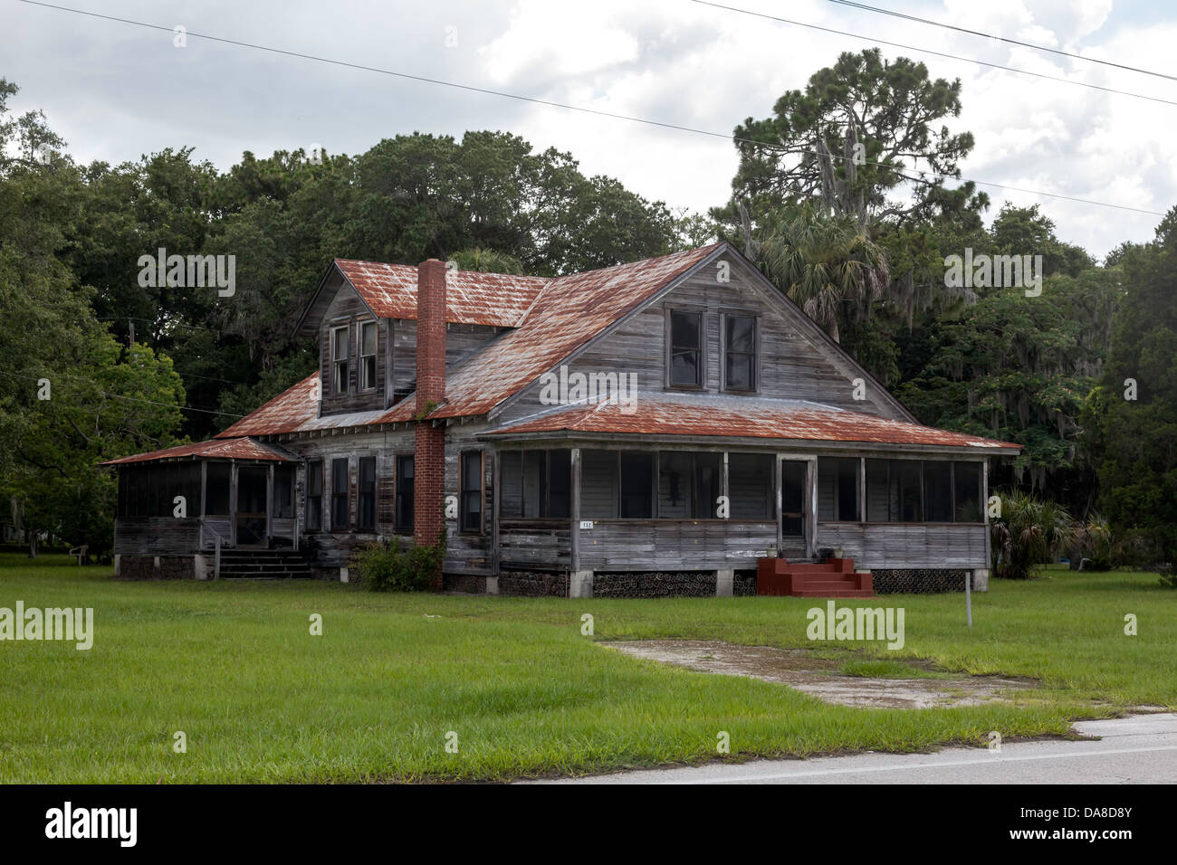Weathered old florida farmhouse with red brick chimney for Farmhouse brick