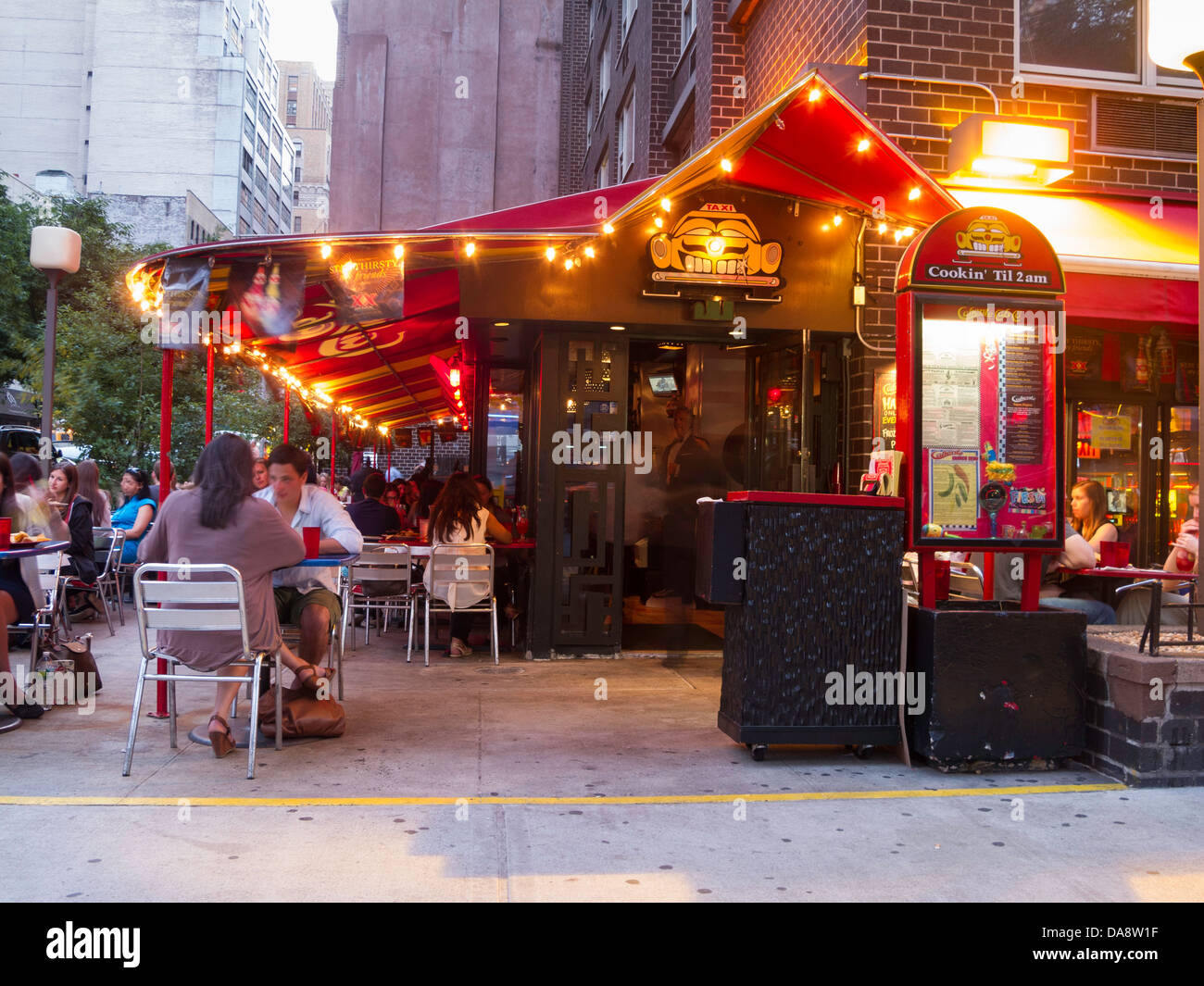 Caliente Mexican Restaurant, Greenwich Village, New York City, U.S.A;  People Enjoying Outdoor Dining, Caliente Cab Co. NYC, USA   Stock Photo