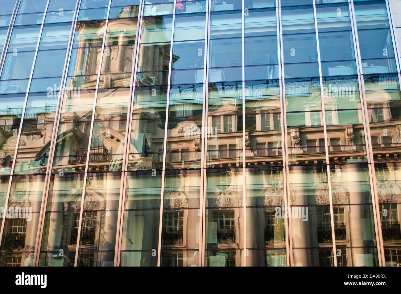 Reflections of an old building in a new glass building ...