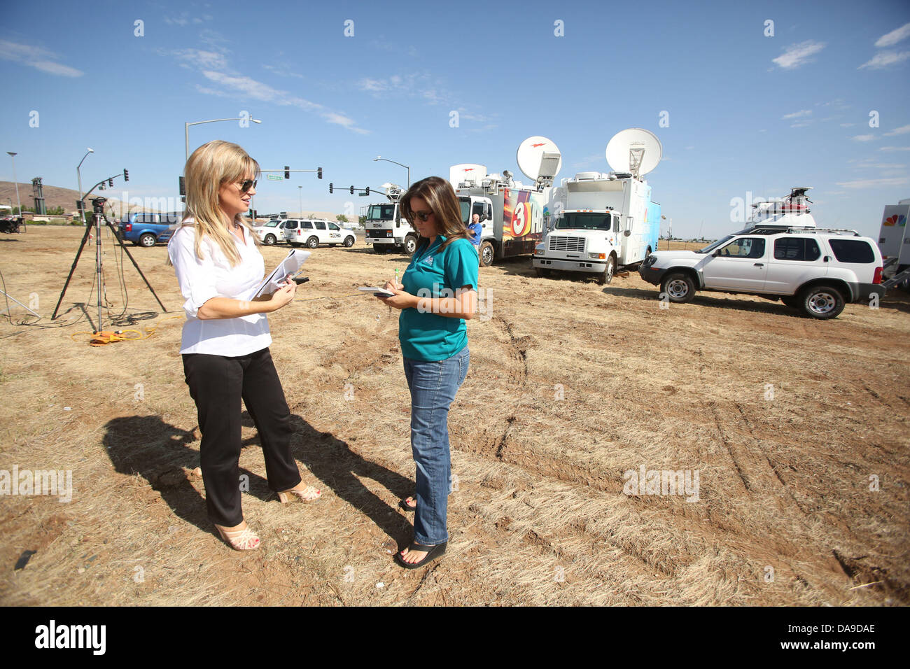 Fay fredricks and lissette martinez of nbc s channel 12 talk outside of tim s toyota center in prescott valley arizona the 19 granite mountain hotshots