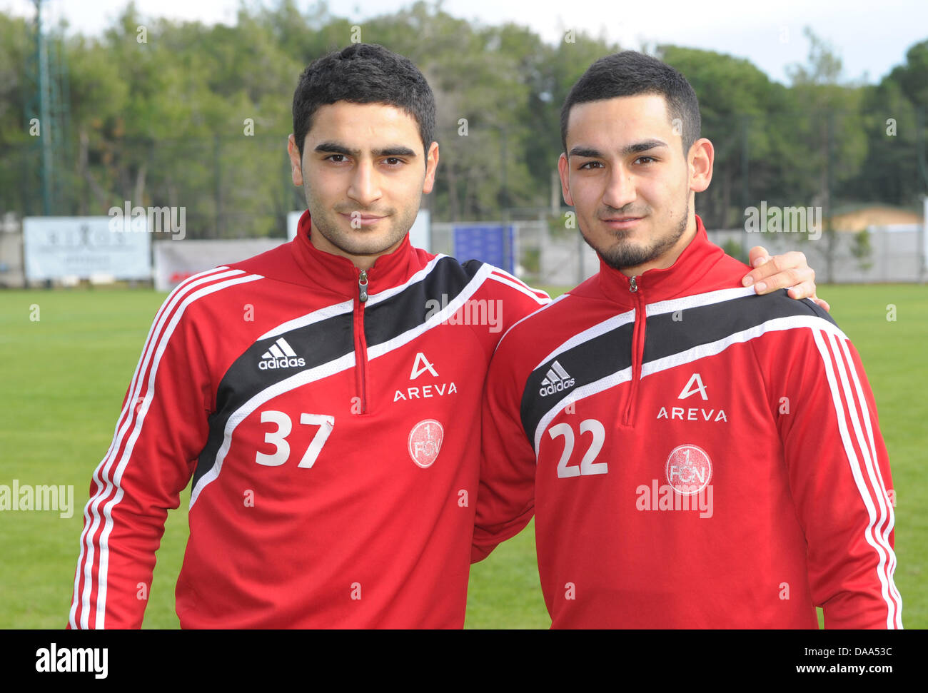 Nuremberg s Mehmet Ekici L and Ilkay Gundogan R smile during