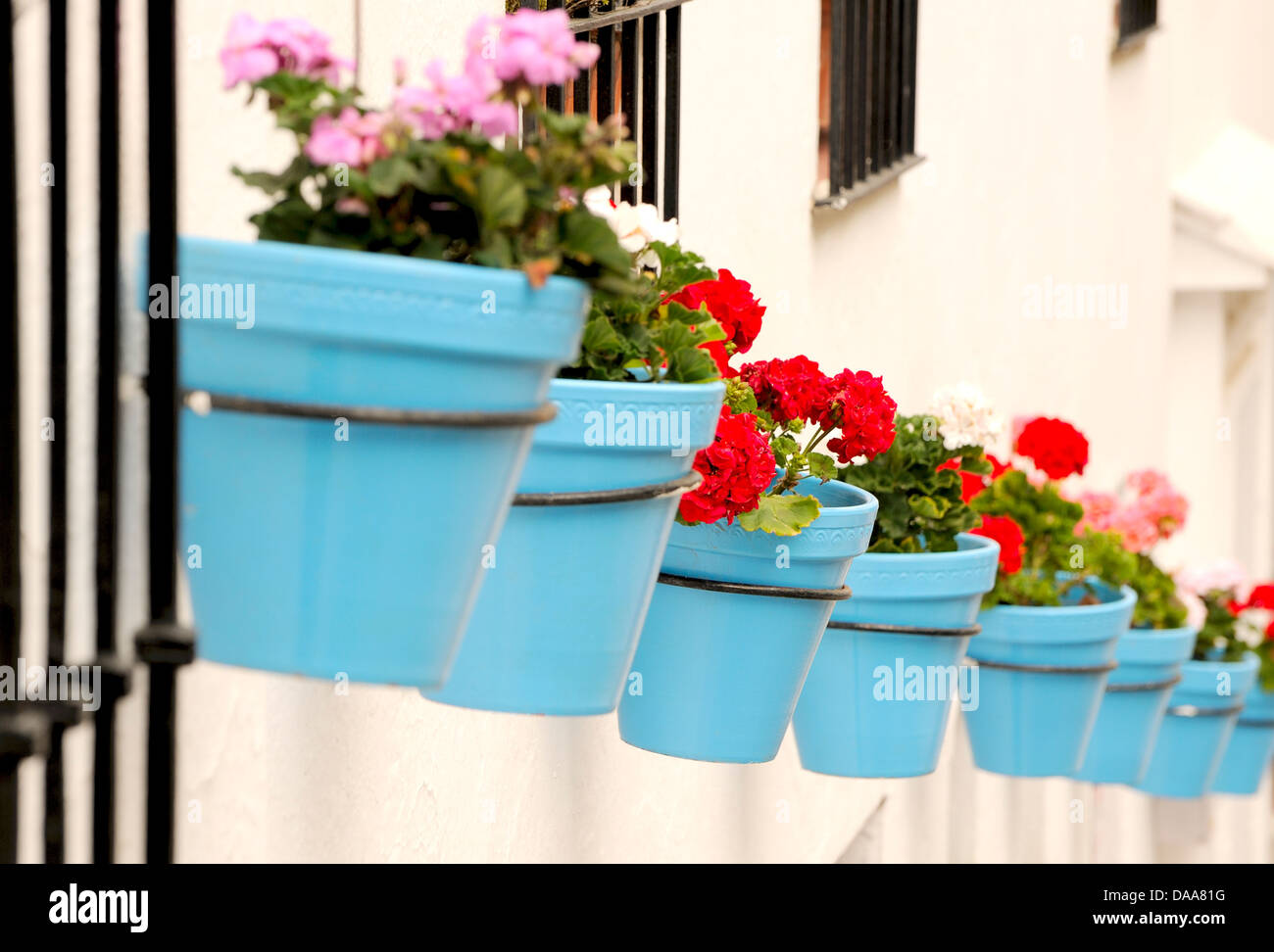 blue flower pots in the hill town of mijas spain stock photo