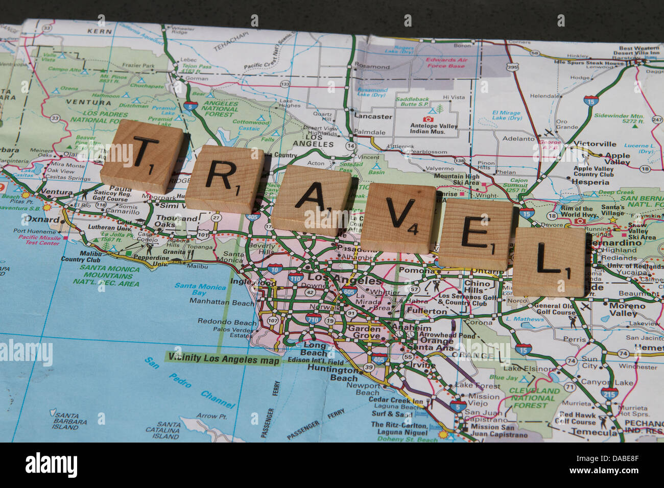 The Word Travel Spelt Out On Wooded Game Blocks On A Map Of – Map Usa Game