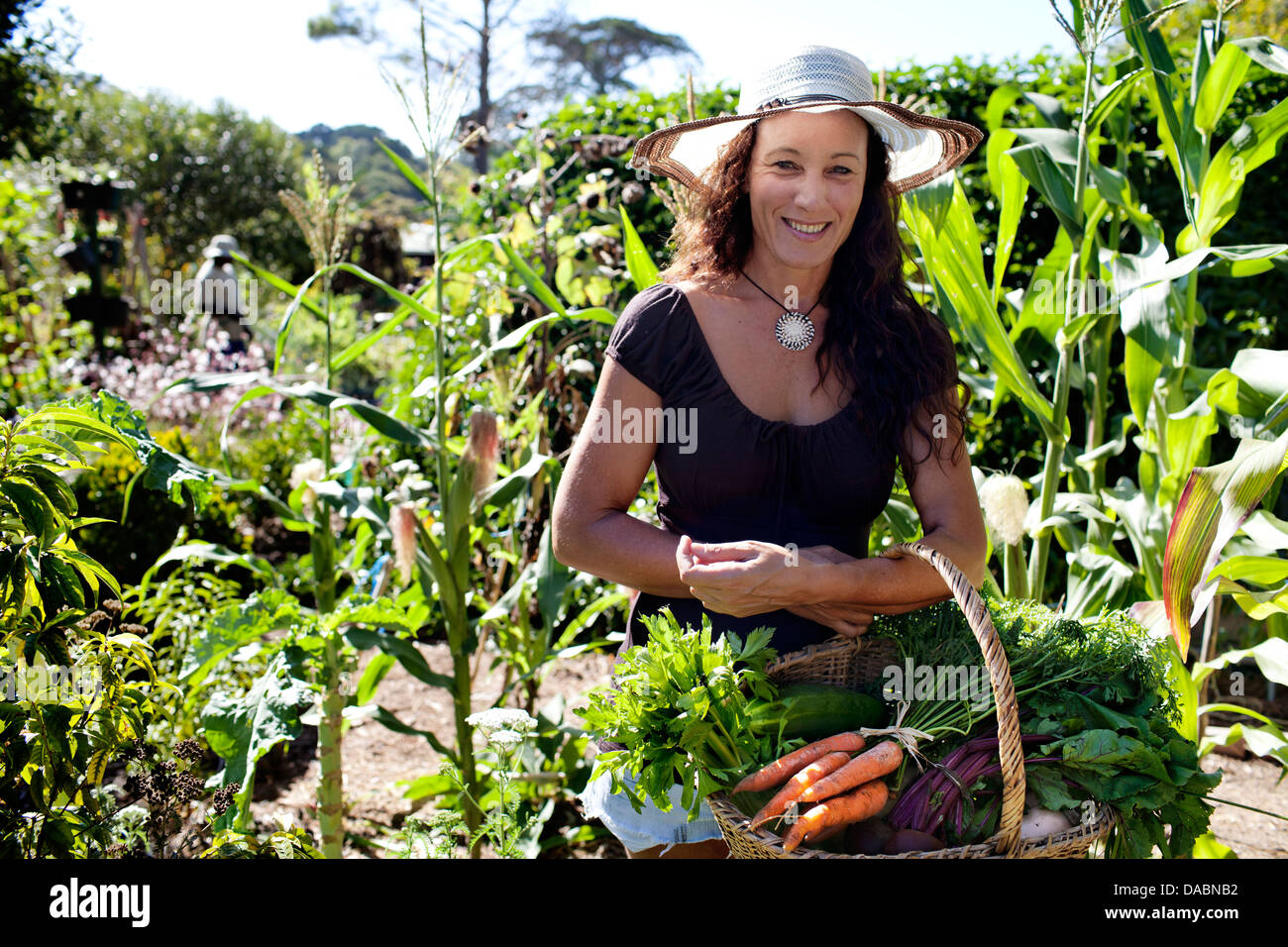 Constantia cape town south africa woman holds basket for Vegetable garden designs south africa