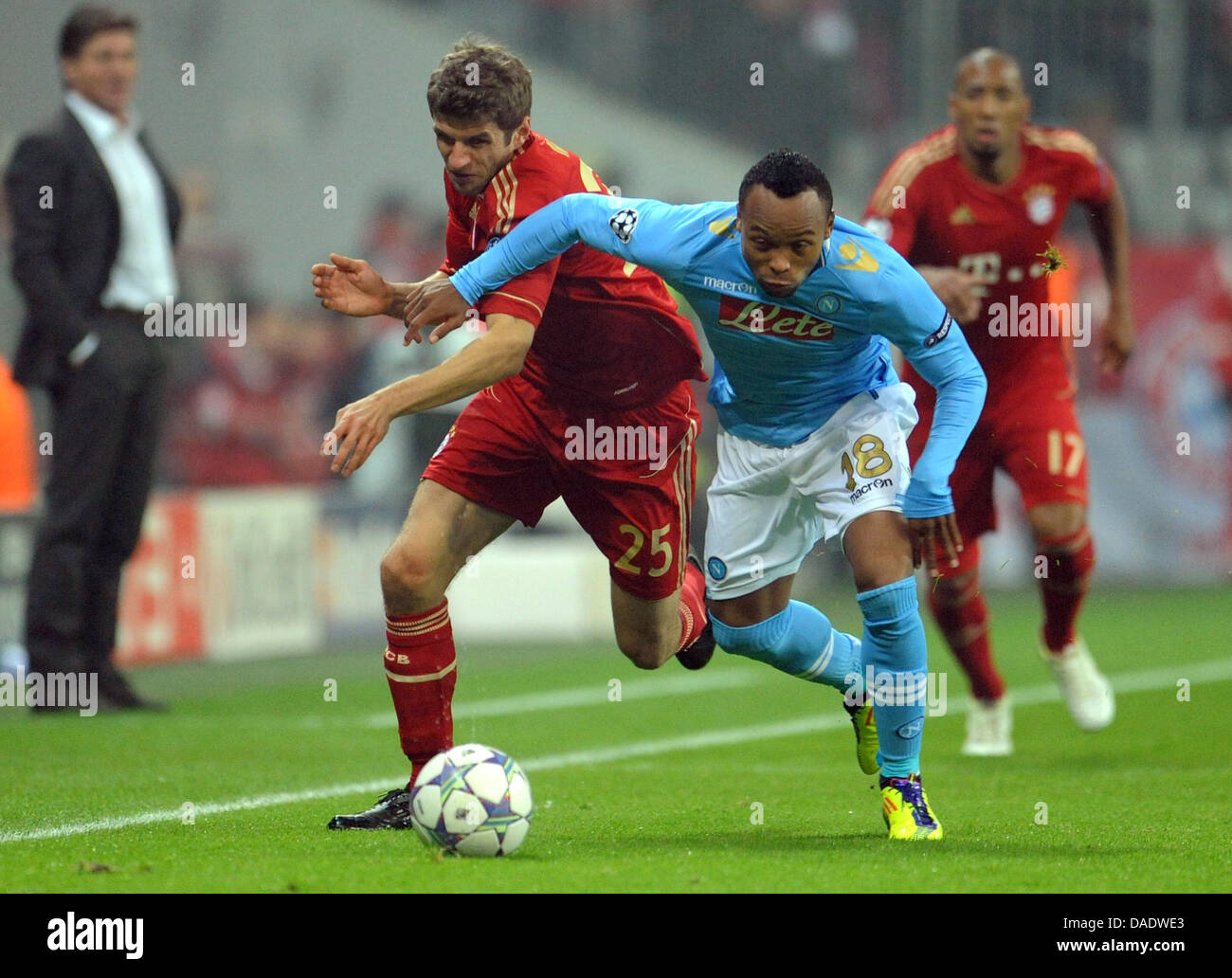 Munich s Thomas Müller L and Juan Zuniga of Naples fight for the