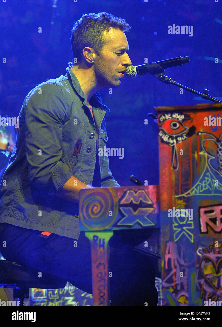 Singer chris martin of the band coldplay plays piano during a concert at the e werk in cologne germany 02 november 2011 tickets for the concert were