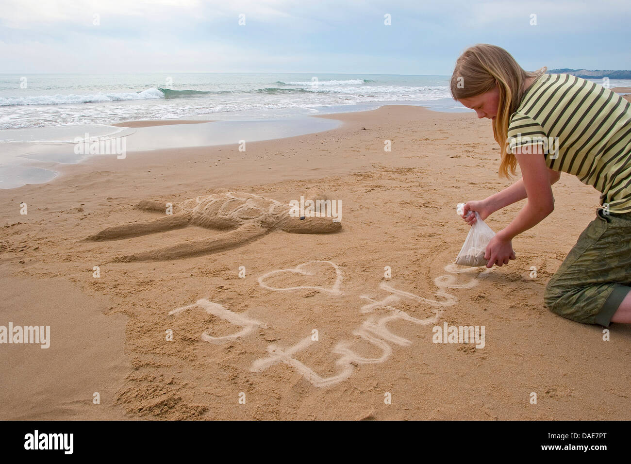 Girl Writing To A Sea Turtle Coming Shore For Egg Deposition Formed At The Beach In Sand Slogan I Love Turtles Beside Italy Sicilia
