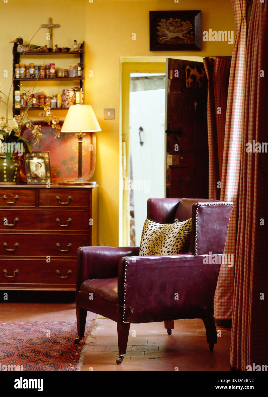 Leather Chairs Living Room Purple Leather Chair In Yellow Country Living Room With Lit Lamp
