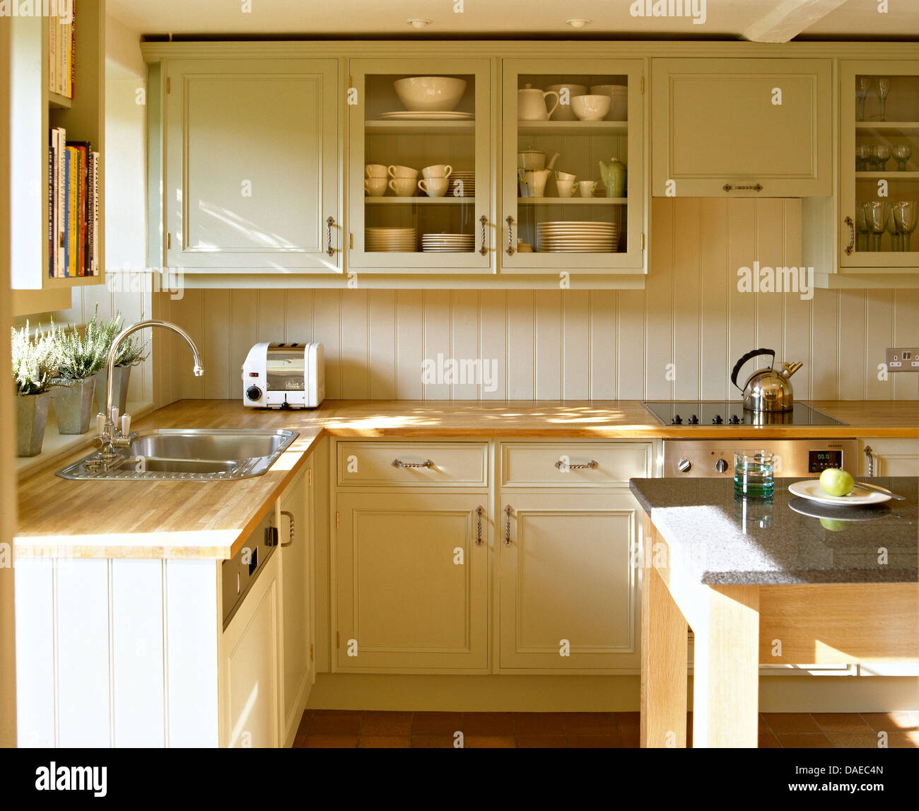 Beech Worktops On Cream Painted Units And Wall Cupboard In Shaker Style Country Kitchen With Dualit Toaster On Worktop