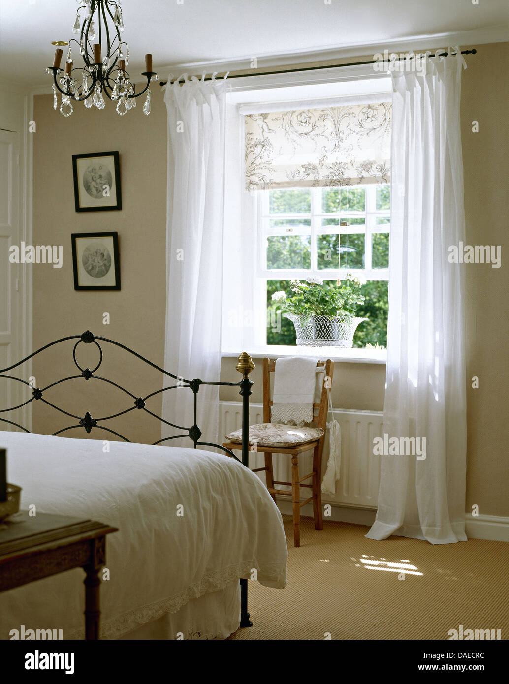Pale Bedroom White Bedlinen On Wrought Iron Bed In Pale Gray Bedroom With White