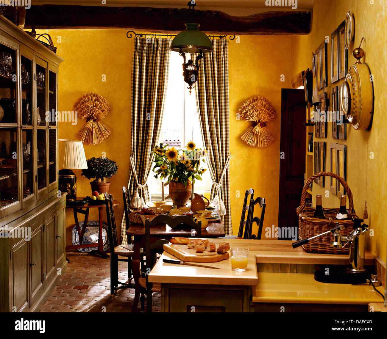 Large Painted Dresser In Bright Yellow French Country Kitchen Dining Room With Checked Curtains On The Windows