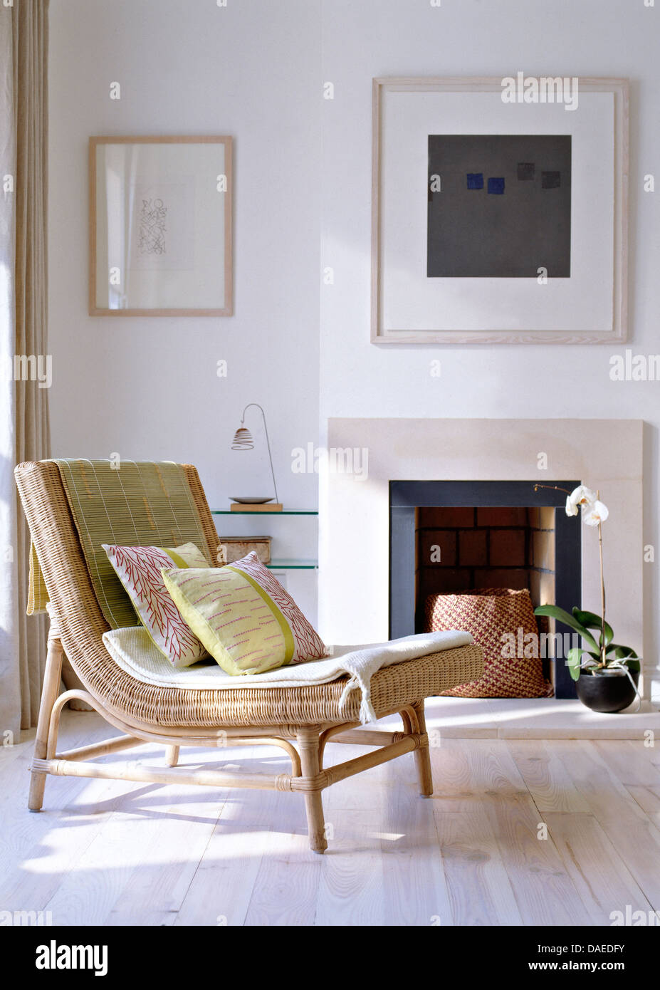 Embroidered Lime Green Cushions On Rattan Chair With Raffia Mat In Modern Living Room Picture