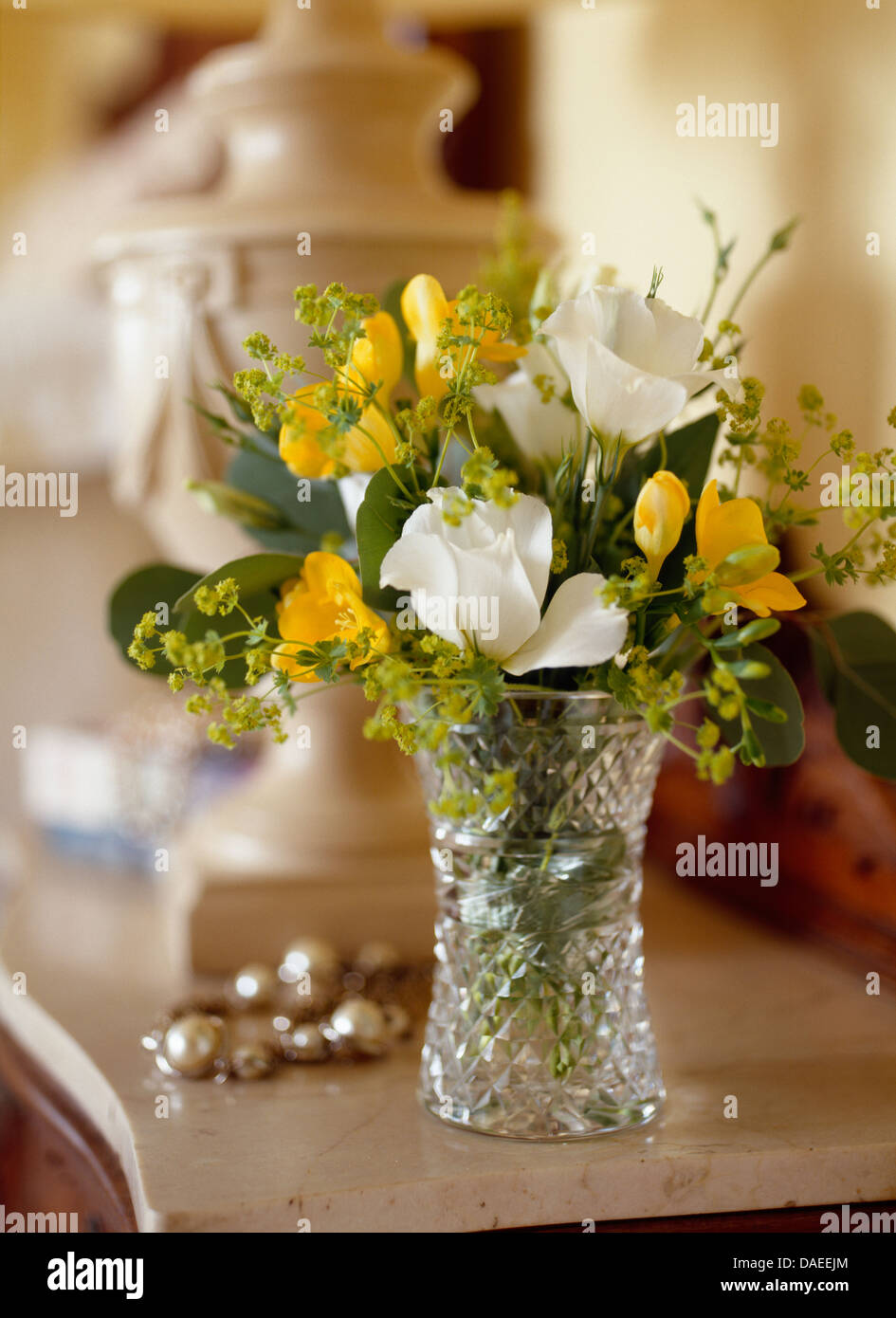 Still life of yellow freesias and white summer flowers in cut still life of yellow freesias and white summer flowers in cut glass vase reviewsmspy